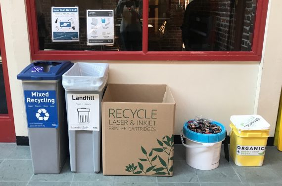 Mixed, battery, ink recycling and composting bins at a waste station on the somerville/medford campus