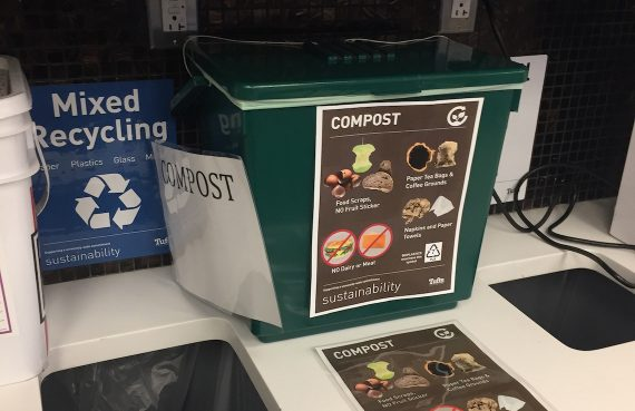 Picture of new composting bin in the library at the Boston Health Sciences campus, next to the existing mixed recycling and landfill bins