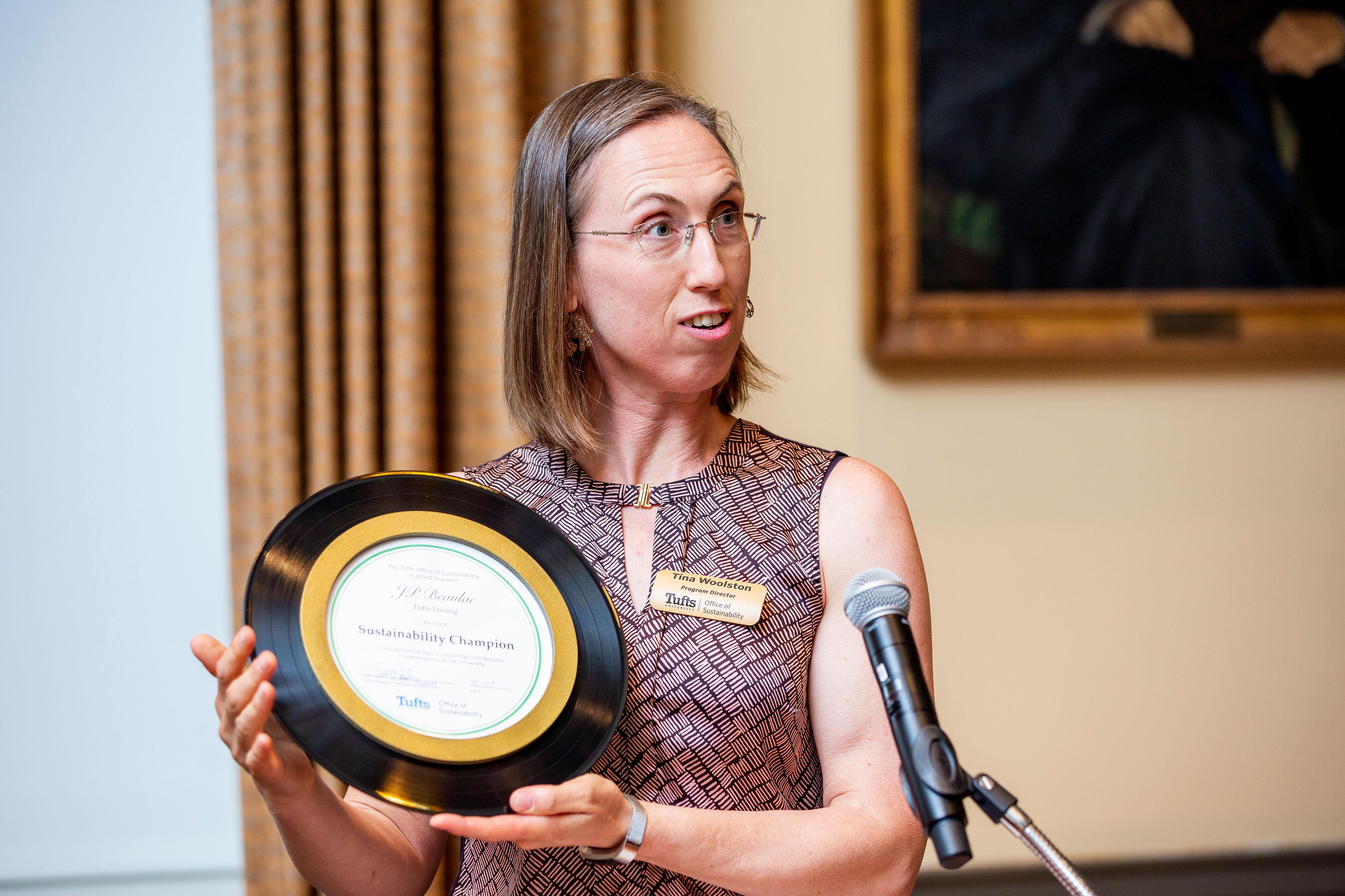 Tina holding Sustainability Champion award