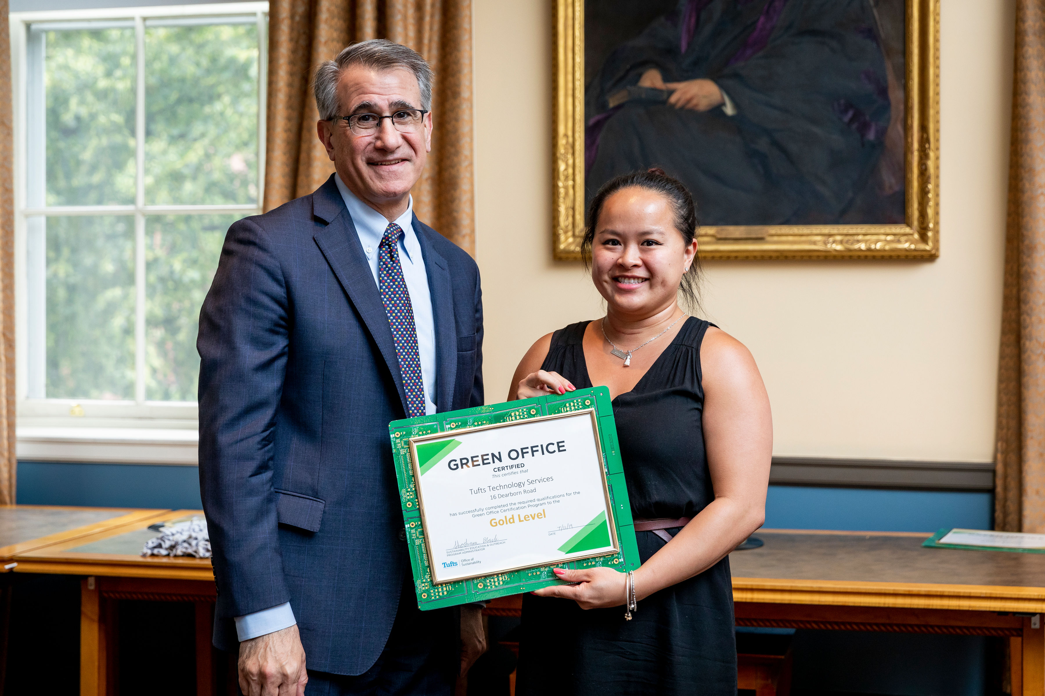 Anthony Monaco awarding someone with Green Office certificate