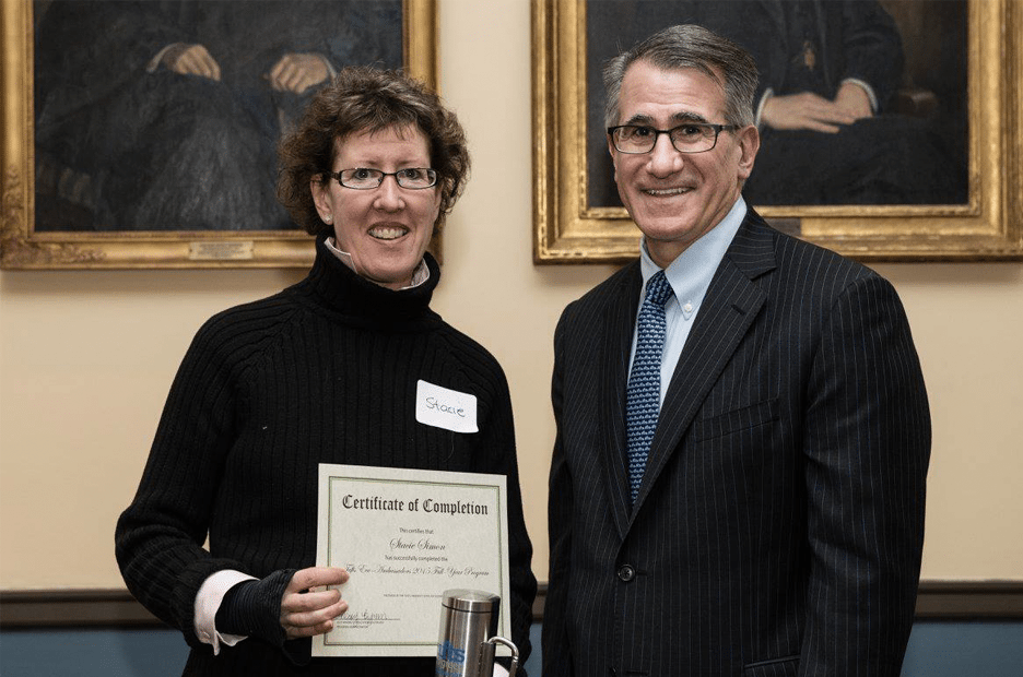 President Monaco presenting Tufts Eco-Ambassador with certificate for the eco-ambassador program