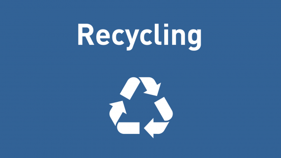 "Blue sign with recycling symbol and the word ""recycling"" on it. Text is white."